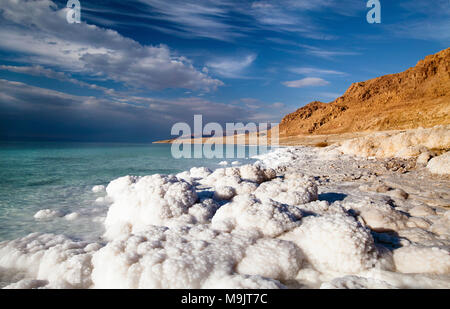 View of the Dead Sea coastline on a sunny day - Stock Photo