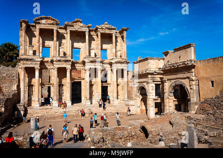 Tourists visiting Library of Celsus and Gate of Augustus in Efes. EPHESUS, TURKEY - SEPTEMBER 30, 2014 - Stock Photo