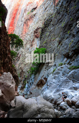 Tourists between the giant rocks and mountain walls. SAKLIKENT CANYON, near Fethiye City, TURKEY – OCTOBER 06, 2011 - Stock Photo