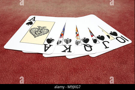 Spades royal flush isolated over red background - Stock Photo