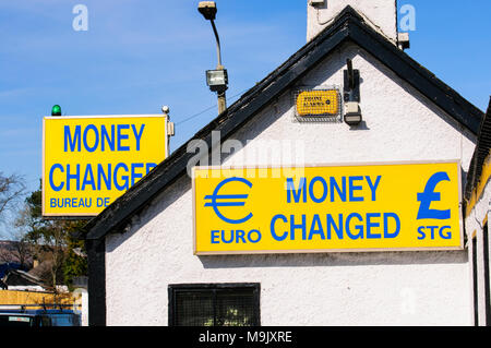 Famous foreign money exchange building on Irish border between Irish Republic and Northern Ireland offering to convert between UK Pounds sterling - Stock Photo