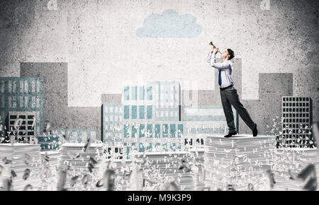 Businessman playing fife while standing among flying letters with drawn cityscape on background. Mixed media. - Stock Photo