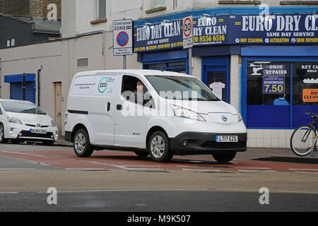 A white Nissan e-NV200 electric van makes deliveries in North London, UK. Branded: Zero Emissions Deliveries' - Stock Photo