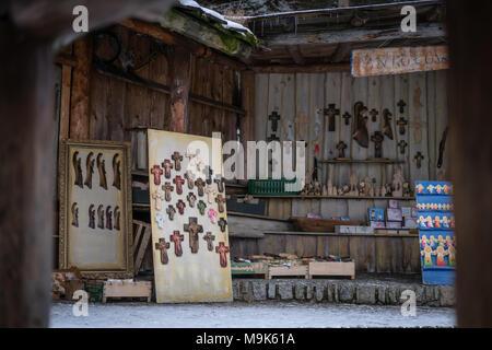 Karpacz, Poland -  February 2018 : Artisan shop display with religious souvenir fridge magnets in  winter resort - Stock Photo