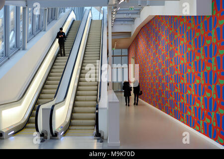 Visitors, Escalators & Aids Wallpaper in Hallway at the Louis Vuitton Foundation Art Museum & Cultural Centre (2006-14) designed by Frank Gehry, Paris - Stock Photo