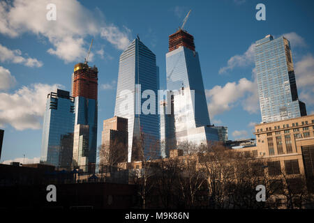 10 Hudson Yards, center left, 30 Hudson Yards, center right, and other Hudson Yards development in New York on Friday, March 16, 2018.The Eugene apartment building is on the right. (© Richard B. Levine) - Stock Photo