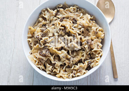 Lazanki - Small flat noodles with cabbage and mushrooms - Stock Photo
