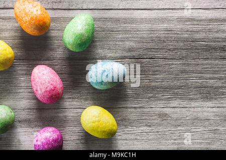 Colorful Eggs on White Rustic Table with Space for Copy - Stock Photo