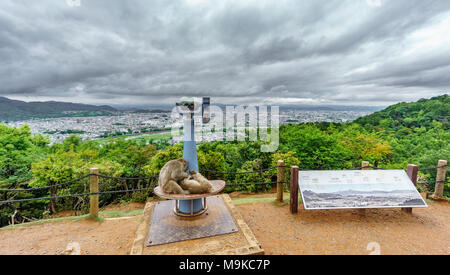 Kyoto from Arashiyama mountain with monkey in viewpoint - Stock Photo