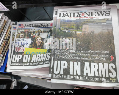Front pages of New York newspapers on Sunday, March 25, 2018 report on the previous days' 'March for Our Lives' rallies around the country and in Washington DC in response to the shooting at Marjory Stoneman Douglas High School in Parkland, Florida allegedly by 19 year-old Nikolas Cruz which left at least 17 dead. Both the intensely competitive New York Daily News and the New York Post use identical headlines. (© Richard B. Levine) - Stock Photo