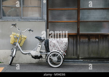 Bicycle in front of old Japanese house - Stock Photo