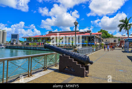 Port Louis, Mauritius - Jan 4, 2017. An ancient cannon at Caudan Waterfront in Port Louis, Mauritius. Port Louis is the country economic, cultural and - Stock Photo