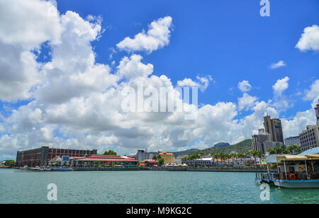 Port Louis, Mauritius - Jan 4, 2017. Cityscape of Port Louis, Mauritius. View from Caudan Waterfront. - Stock Photo