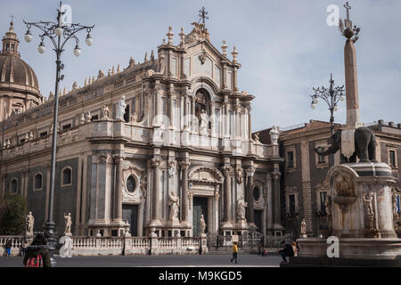 Piazza del Duomo square with the façade of the cathedral and the Elephant Fountain 'u Liotru', symbol of Catania, Sicily, Italy. - Stock Photo