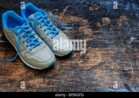 Top View of Blue Shoes With Old Wooden Blackboard Background. Moody Shoes Photography. - Stock Photo