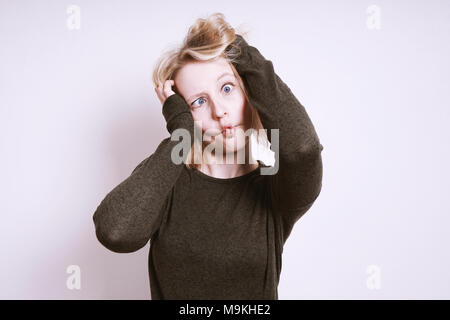 silly young woman kidding around and grimacing - Stock Photo