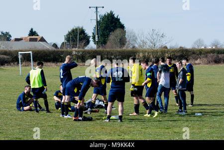 Sunday League football, players at the half-time interval, Leamington Spa, Warwickshire, England, UK - Stock Photo