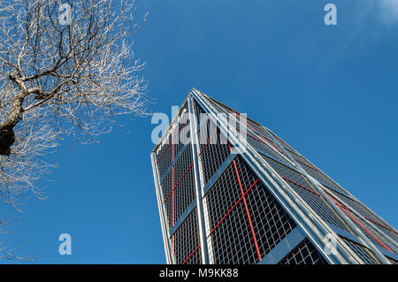 Madrid, Spain - March 26, 2018: Low angle view of KIO Tower office building in Madrid agaisnt blue sky - Stock Photo