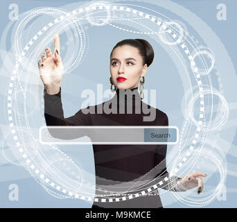 Young woman with empty address bar on virtual screen . New technology, www and internet surfing concept - Stock Photo