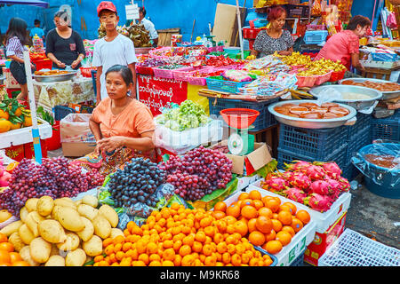 YANGON, MYANMAR - FEBRUARY 14, 2018: The stall with fresh fruits in Chinatown market - popular shopping area among tourists and locals, on February 14 - Stock Photo