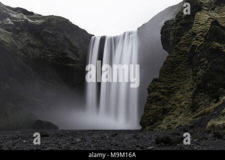 Serene Long Exposure of Skogafoss Waterfall in South Iceland - Stock Photo