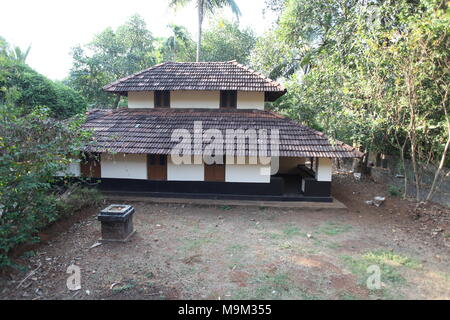 traditional kerala houses with 2-3 storied,tiled roof at a village with lot of greenery - Stock Photo