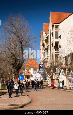 Morocco, Ifrane, Middle Atlas resort, visitors in pedestrianised road outside Appart Hotel - Stock Photo