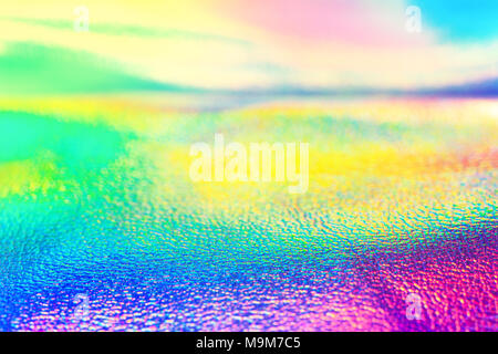 Rainbow real holographic foil neon texture wallpaper. Vibrant neon texture. Trendy background. - Stock Photo