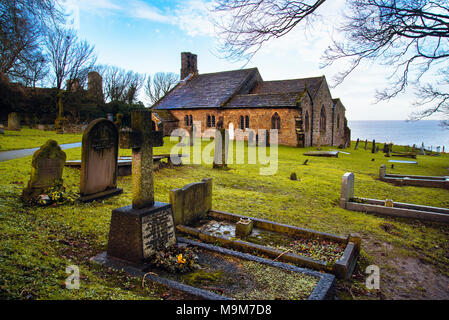 The medieval Church of St Peter, Heysham, Lancashire, with Morecambe Bay beyond - Stock Photo