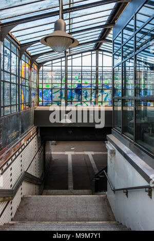 Berlin-Schöneberg. Friedenau S-bahn railway station serves S1 line. glass covered entrance,old lamps & steep steps - Stock Photo