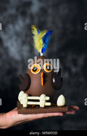 closeup of a funny chocolate chick as a spanish mona de pascua, a traditional confection given by godparents to godchild on Easter and typically eaten - Stock Photo