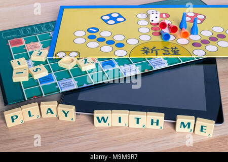 Text play with me on board games and shut off tablet - Stock Photo