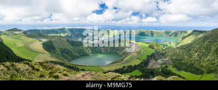 Crater and Valley Road through volcano country: Lagoa Santiago, Azul and Verde as well as the ocean are included in this detailed view from the end of the viewpoint trail. - Stock Photo