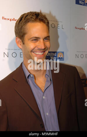 MIAMI, FL - NOVEMBER 30: Actor Paul Walker, who shot to fame as star of the high-octane street racing franchise 'Fast & Furious,' died Saturday in a car crash in Southern California. He was 40. Walker's publicist Ame van Iden confirmed his death, but said she could not elaborate beyond statements posted on Walker's official Twitter and Facebook accounts. Walker was a passenger in a friend's car and both were attending a charity event for his organization, Reach Out Worldwide, in the community of Valencia in Santa Clarita, about 30 miles north of Hollywood. The website for the charity said the  - Stock Photo