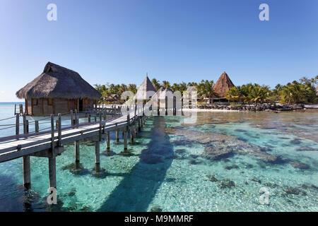 Bungalows, water bungalows at the pier in lagoon, Tikehau Pearl Beach Resort, Tikehau Atoll, Tuamotu Archipelago - Stock Photo