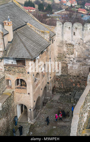 Bolkow, Poland -  February 2018 : Tourists in the courtyard of the ruins of the medieval Bolkow Castle as seen from the watchtower, Lower Silesia - Stock Photo