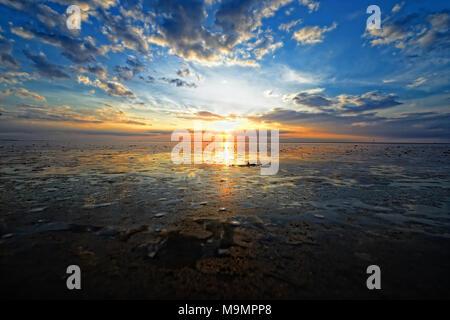 Dramatic sunset on the beach, Langeoog, East Frisian Islands, Germany - Stock Photo