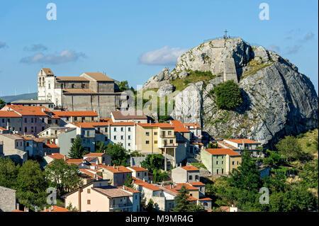 View of mountain village Pietrabbondante with medieval tower and church Chiesa di Santa Maria Assunta on rock Morg Caraceni - Stock Photo