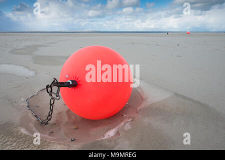 Buoy on the beach in the sand, Langeoog, North Sea, East Frisia, Lower Saxony, Germany - Stock Photo