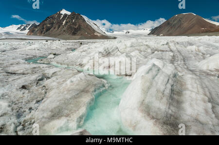 Icy landscape with glacial stream, Altai mountains, Mongolia - Stock Photo