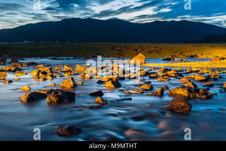Orkhon river with rocks in dramatic sunlight, Mongolia - Stock Photo