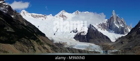 Snow-covered mountain range with Cerro Torre and Torre Glacier, Parque Nacional Los Glaciares, Santa Cruz Province, Patagonia - Stock Photo