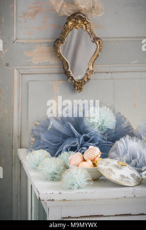 French decor with tulle pom poms and meringue. - Stock Photo