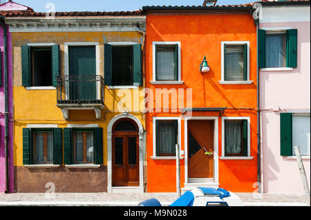 Orange and yellow house in Burano, a little island in Venetian lagoon, Italy, Europe - Stock Photo