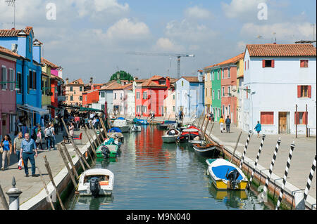 BURANO, VENICE, ITALY - APRIL 16, 2017 : View of the canal and characteristic colorful houses typical of this island located in Venetian lagoon - Stock Photo