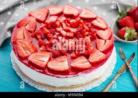 Homemade creamy fresh strawberry red fruit cake - Stock Photo
