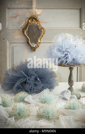 Tulle pom poms and old French mirror decoration - rustic metal cake stand - Stock Photo
