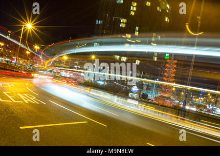 Big Bus Bussing a Busload of Bright Light Business - Stock Photo