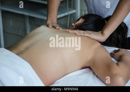 Cosmiatra doing relaxing massages to a patient - Stock Photo