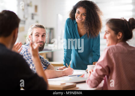 Meeting at office. a black woman talking with her colleagues  - Stock Photo